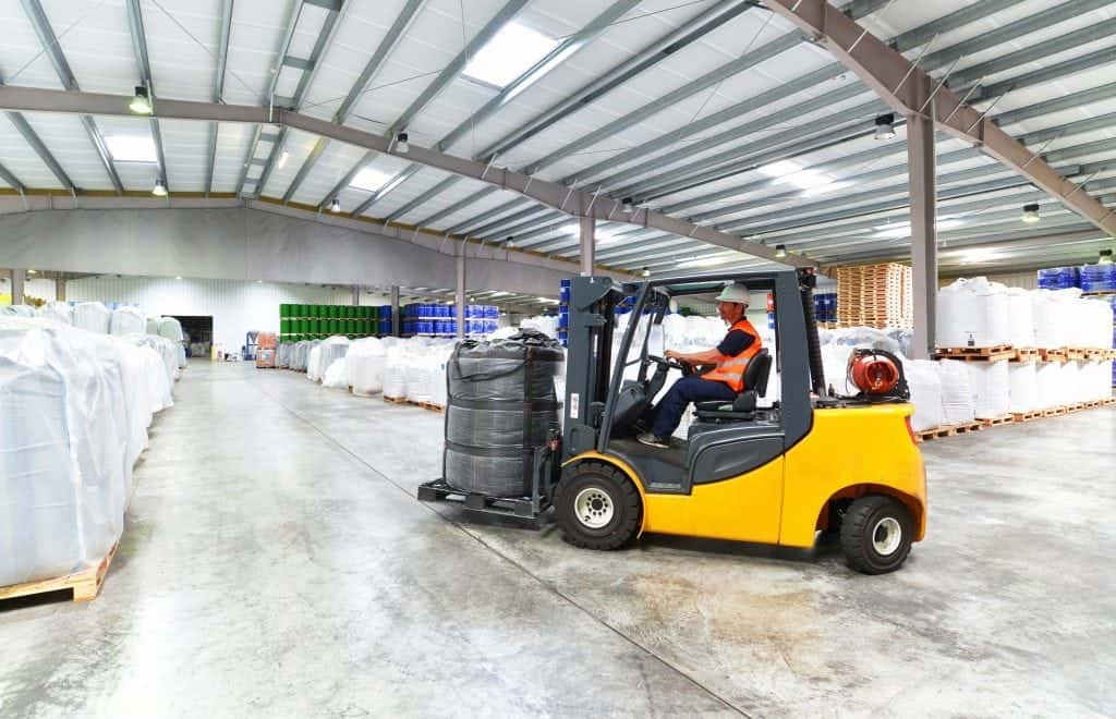 Propane (LP) powered forklift operating within a warehouse that contributes carbon monoxide gas to indoor air