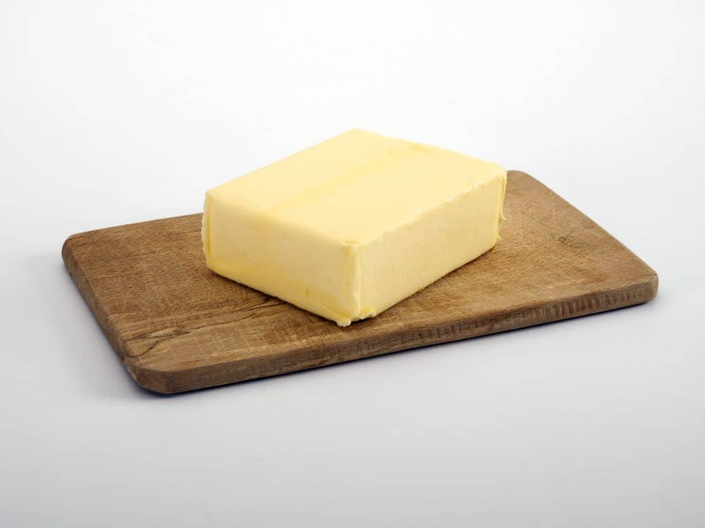butter on a wooden tray
